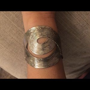 Jewelry - Silver toned cuff bracelet with whimsical swirl